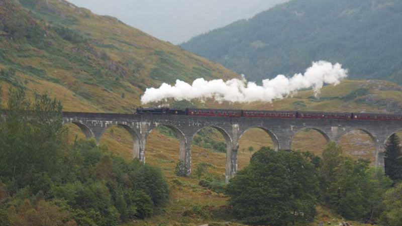 View of Glenfinnan Viaduct and Jacobite Steam Train