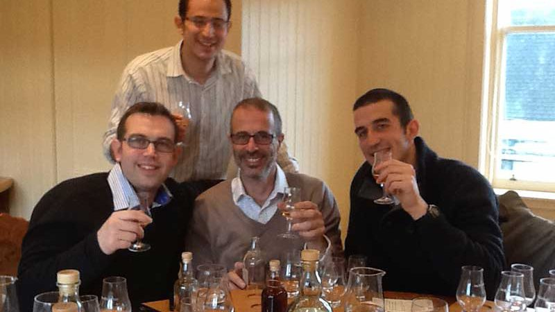Guests enjoying a dram at Bowmore Distillery Islay